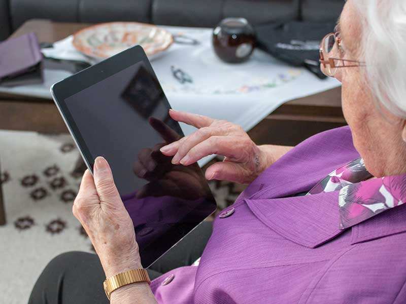 older person using a tablet